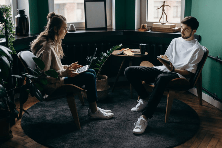 A couple discussing finances in a modern living room