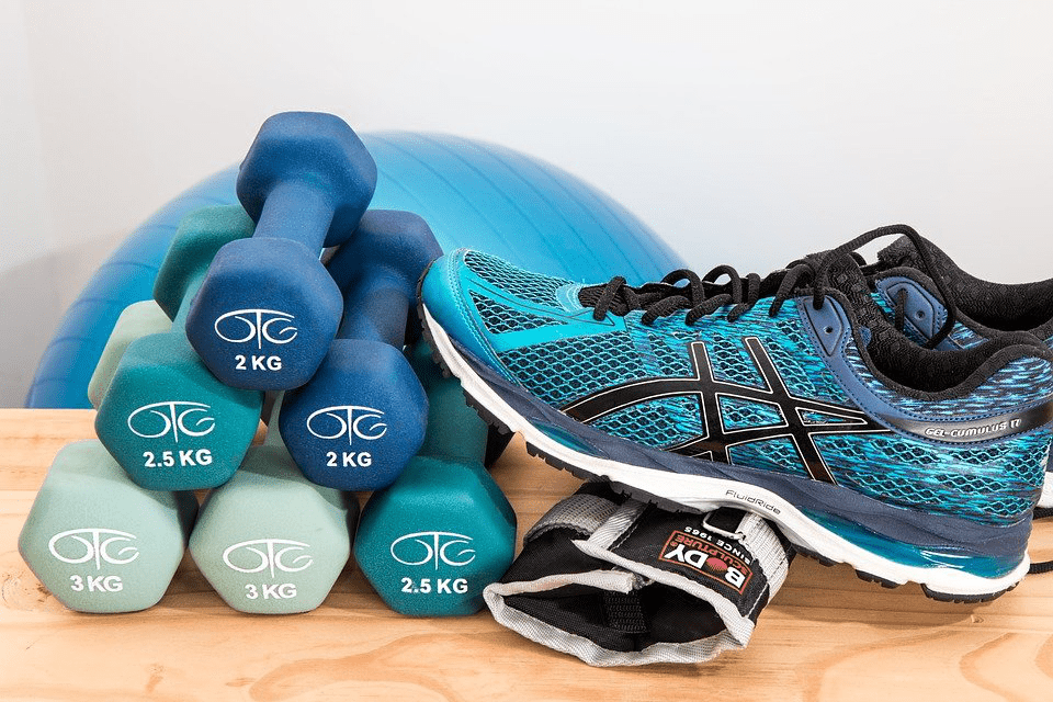 A set of dumbbells and a pair of shoes