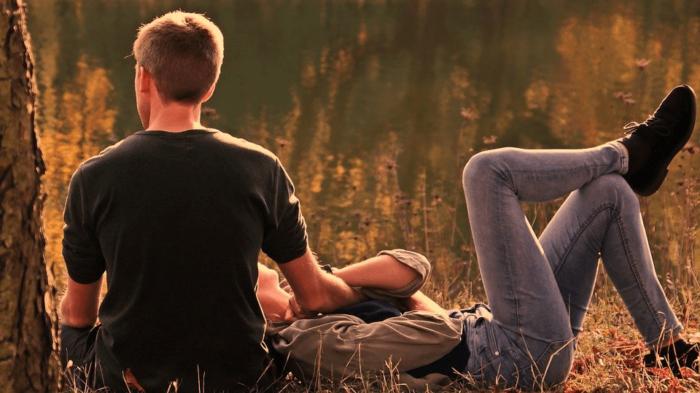 A couple having a conversation outdoors