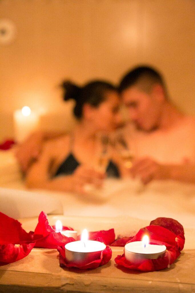 Candlelit bath couple.