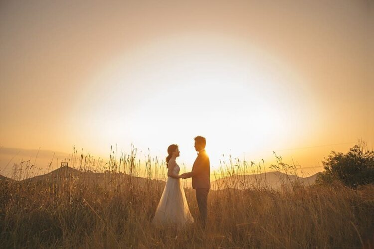 Couple in middle of the field.