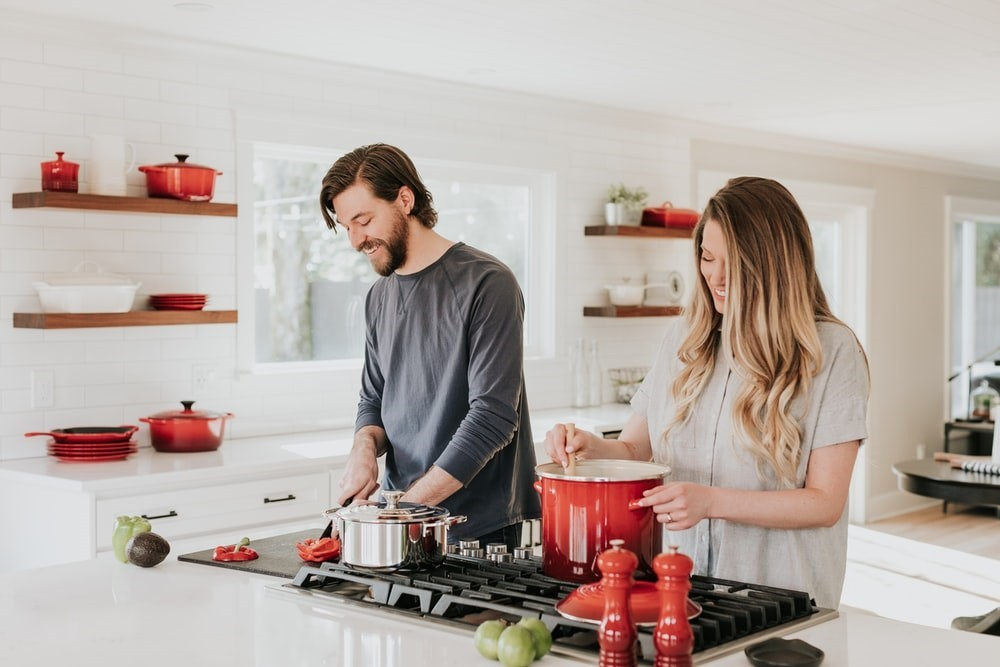 a man and a woman in a kitchen